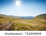 mountain path hiker on a... | Shutterstock . vector #710349604