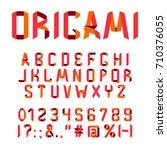 origami ribbon folded uppercase ... | Shutterstock .eps vector #710376055