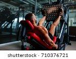 sexy muscular men using a leg... | Shutterstock . vector #710376721
