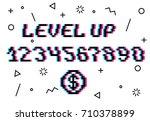vector level up pixel 8 bit...   Shutterstock .eps vector #710378899
