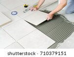 the hands of the worker are... | Shutterstock . vector #710379151