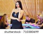 pretty woman in black dress...   Shutterstock . vector #710380699