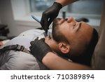 a muscular man sitting in a...   Shutterstock . vector #710389894