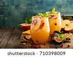 fall sangria cocktail with... | Shutterstock . vector #710398009