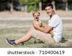 a teenager with a dog is... | Shutterstock . vector #710400619