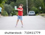 little boy playing with soap... | Shutterstock . vector #710411779