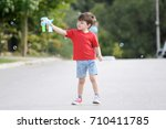 little boy playing with soap... | Shutterstock . vector #710411785