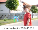 little boy playing with soap... | Shutterstock . vector #710411815