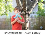 little boy playing with soap... | Shutterstock . vector #710411839