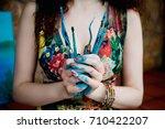 the artist holds the paint... | Shutterstock . vector #710422207