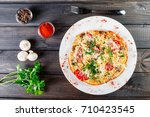 omelette with slices ham ... | Shutterstock . vector #710423545