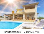 holiday house with pool | Shutterstock . vector #710428741