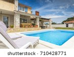 holiday house with pool | Shutterstock . vector #710428771