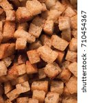 Small photo of Butter toasted rye bread cubes, so called croutons to garish or decorate dishes like soups and salads