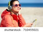 sporty woman on the beach... | Shutterstock . vector #710455021