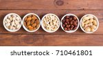 mix of nuts   pistachios ... | Shutterstock . vector #710461801