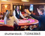 cute lady casino dealer at... | Shutterstock . vector #710463865