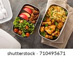 lunch boxes with food ready to... | Shutterstock . vector #710495671