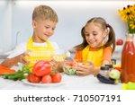 happy boy pours sunflower oil... | Shutterstock . vector #710507191