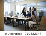 young male and female coworkers ... | Shutterstock . vector #710522347