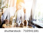 business man thinking about... | Shutterstock . vector #710541181