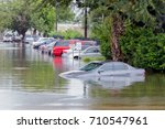 cars submerged  in houston ... | Shutterstock . vector #710547961