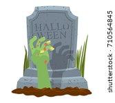 halloween. grave and hand of... | Shutterstock .eps vector #710564845