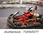girl in helmet drives in go... | Shutterstock . vector #710565277