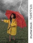 little girl in a raincoat... | Shutterstock . vector #710577121