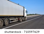 truck on road with container