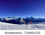 a lone mountaineer walking... | Shutterstock . vector #710601151