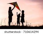 happy parent with children... | Shutterstock . vector #710614294