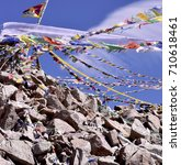 Small photo of Prayer flags tied all the way to the top of the rocky peak next to the Khardung La pass, where a trio of Votive Stupas have been built to gain spiritual benefits.