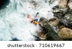 an extreme whitewater kayaker... | Shutterstock . vector #710619667