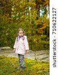 cute little girl in the autumn... | Shutterstock . vector #710622127