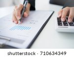 accounting calculating... | Shutterstock . vector #710634349