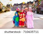 kids and parents on halloween... | Shutterstock . vector #710635711