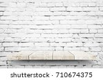 wooden shelf on white brick... | Shutterstock . vector #710674375