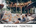 stylish hipster couple cuddling ... | Shutterstock . vector #710675311