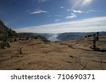 Small photo of Preikestolen, Norway - July, 01, 2017: tourists admire and relax on the summit of Preikestolen
