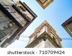 specular view of the bell tower ... | Shutterstock . vector #710709424