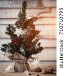 christmas fir tree on wooden... | Shutterstock . vector #710710795