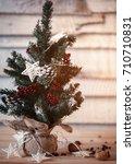 christmas fir tree on wooden... | Shutterstock . vector #710710831