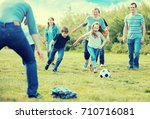 friendly and glad family... | Shutterstock . vector #710716081