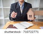 real estate agent offer house... | Shutterstock . vector #710722771