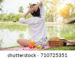 happy young girl relaxing at... | Shutterstock . vector #710725351