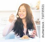 Portrait Of Smiling Girl Eatin...