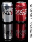 London, United Kingdom - May 11, 2017. Can of Diet Coke and can of Classic Coca-Cola. Diet Coke is sweatened with aspartame instead of sugar,  - stock photo