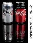 London, United Kingdom - May 11, 2017. Can of Coke Zero and Diet Coke. Like Diet Coke, Coke Zero is sweatened with Aspartame, but each has its own distinctive flavour and sweatener blend. - stock photo