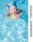 little girl playing  in blue... | Shutterstock . vector #71075227